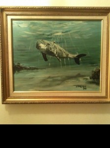 This is my very first Peter O'Neill original painting.  I first met Peter at a little café on St George St. in St Augustine FL through my dad who had a shop on St George St.  It was on a Sunday & we had just come from Mass & we went there to have breakfast & Peter was in there & had several of his paintings on display in P.K.'s Café.  It also happened to be my birthday & I just fell in love with this one painting in particular.  It is of a dolphin, under the water, almost to the surface & to me it looks almost 3D.  I absolutely LOVE anything ocean, beach scenes etc. but dolphins & whales are my favorites so of course this one stuck out to me.  I remember telling him how beautiful I thought this painting was & we continued on with our breakfast.  The next thing I know, Peter walked away & came back with the painting & said here, I want you to have it, happy birthday!  I was floored & I thanked him, but I told him I just can't do that & he insisted.  I still said thank you so much, but I just can't & he looked at me & said why not??  You think it's beautiful & that is the BEST compliment you could EVER give an artist so please, take it.  And please remember I had JUST met him!  I STILL have this painting & it hangs in my front walkway.  THANK YOU PETER!!  I'll NEVER forget that!!!